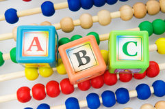 Alphabet blocks and abacus Royalty Free Stock Photography
