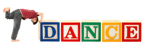 Alphabet Blocks and Adorable Boy DANCE. Giant alphabet blocks and adorable seven year old boy spelling out the word DANCE Royalty Free Stock Photography