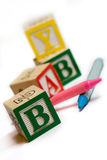 Alphabet blocks with crayons Stock Photo