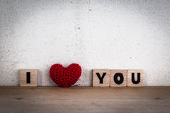 Alphabet Blocks and Red Heart Shaped Silk Stock Image