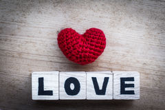 Alphabet Blocks and Red Heart Shaped Silk Stock Photo