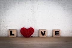 Alphabet Blocks and Red Heart Shaped Silk Royalty Free Stock Photos