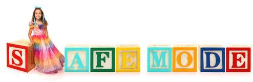Alphabet Blocks SAFE MODE. Colorful alphabet blocks spelling the word SAFE MODE royalty free stock image
