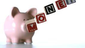 Alphabet blocks spelling money dropping down Stock Images