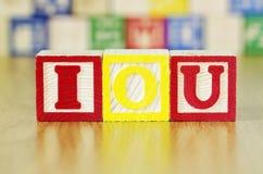 Alphabet Blocks Spelling out IOU Stock Photos