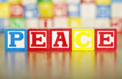 Alphabet Blocks Spelling out Peace Stock Photos