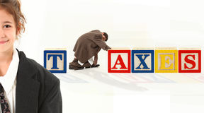 Alphabet Blocks TAXES. Colorful alphabet blocks spelling the word TAXES Stock Photos