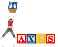 Alphabet Blocks TAXES Stock Photos