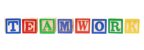 Alphabet Blocks with Teamwork Concept Royalty Free Stock Photography