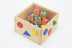 Alphabet Blocks in Toy Box Royalty Free Stock Images