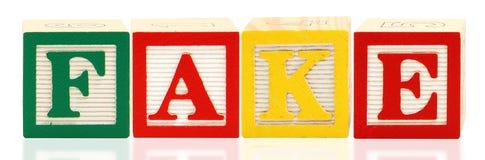Alphabet blockt FÄLSCHUNG Stockbilder