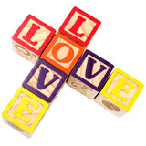 Alphabet blockt Rechtschreibung-Liebe Criss in der Querart Lizenzfreies Stockbild