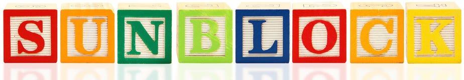 Alphabet blockt SUNBLOCK Stockbilder