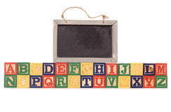 Alphabet building blocks with chalkboard Royalty Free Stock Images