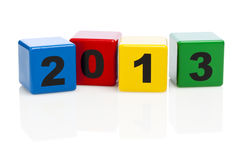 Alphabet building blocks showing year 2013. 2013 printed on four alphabet building blocks stock photography