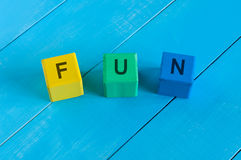Alphabet building blocks that spelling the word. Fun Royalty Free Stock Photo