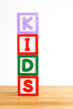 Alphabet building blocks that spelling the word kids Royalty Free Stock Image