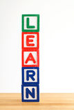 Alphabet building blocks that spelling the word learn Stock Photos