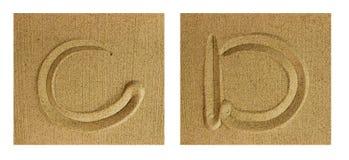 Alphabet C-D on sand Stock Photos