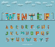 Alphabet cartoon winter house, font. Vector alphabet in the form of houses with winter surroundings, environment, font houses Stock Photos