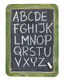 Alphabet in chalk on blackboard Stock Photos