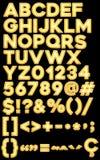 Alphabet, chiffres et caractères particuliers des ballons jaunes Photographie stock