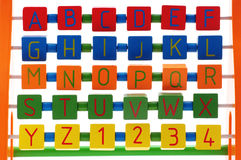 Alphabet for children. Children's alphabet learning board with letters and numbers Royalty Free Stock Photos