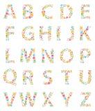 Alphabet coloré de fleurs Photographie stock