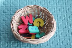Alphabet colorful foam in the basket royalty free stock images