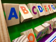 Alphabet from colorful wooden cubes Royalty Free Stock Photos