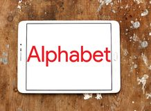 Alphabet conglomerate logo. Logo of Alphabet conglomerate company on samsung tablet on wooden background. Alphabet Inc. is an American multinational conglomerate royalty free stock image
