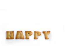 Alphabet cracker / bread wording happy on white background isola. Ted Royalty Free Stock Images