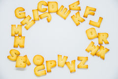Alphabet cracker with space in the middle on white background. 1 Stock Photography