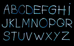 Alphabet created with light stock image