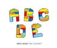 Alphabet created from playing bricks. Stock Image