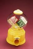 Alphabet Cubes in Bubblegum Machine. On Red Background Stock Photos