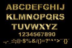 alphabet 3d avec des lettres d'or sur un fond noir Photos stock