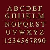 Alphabet d'or avec des nombres photographie stock