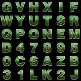 Alphabet d'or avec le vert Photographie stock libre de droits