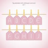 Alphabet d'étiquette avec la pince à linge et le cordon Photo stock