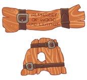 Alphabet de bois et de cuir Marquez avec des lettres A Photo stock
