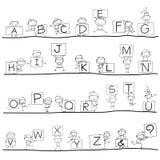 Alphabet de bonheur de bande dessinée de dessin de main Photographie stock