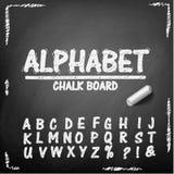 Alphabet de dessin de main de panneau de craie Photographie stock libre de droits