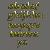 Alphabet de luxe d'or Lettres en métal jaune Photographie stock libre de droits