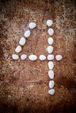 '4' alphabet de nombre a fait la pierre de blanc de forme Photos stock