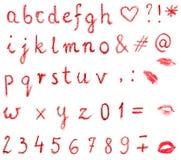 Alphabet de rouge à lèvres Photographie stock libre de droits