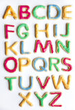 Alphabet in decorated colourful cookies Stock Photography