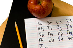 Alphabet on desk Stock Image