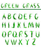 Alphabet, draw letters of green grass Stock Photos