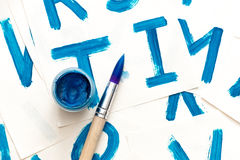 Alphabet drawing. Process of creating watercolor font. Royalty Free Stock Images